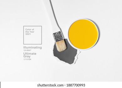 White brush on light background with trend colors. Minimalistic picture for article, banner or poster. Trendy colors of 2021 year - gray and yellow.