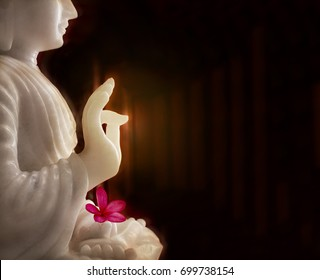 White Buddha wiith flower, Buddha blessing pose