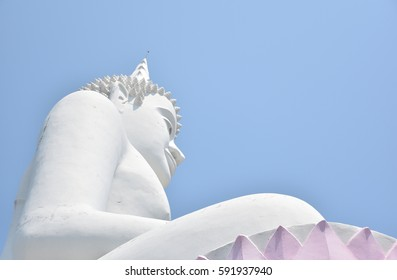 White budha with blue sky background.