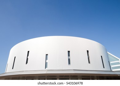 White building with blue sky background