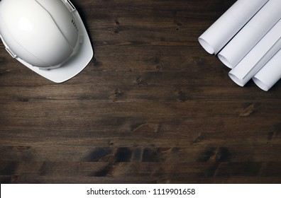 Blueprint paper stock photos images photography shutterstock white building helmet with white blueprint rolls project drawings on brown wooden board malvernweather Choice Image