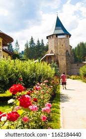 White building monastery in mountains,Romania , Voronet  ,walls ,stone
