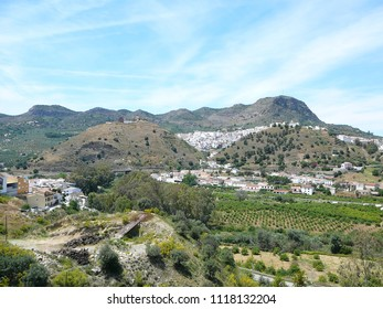 White buildings crowding hillside in Andalusian village