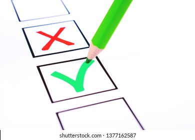 White bulletin with checkboxes and green pencil with red cross and tick drawn as positive and negative selection signs. Elections, choice and approval concept. Copy space for text.