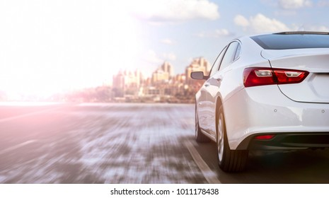 white business car moving on highway