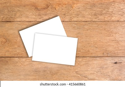 White business card on wooden table