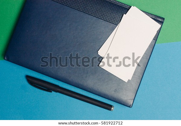 White business cards, notebook