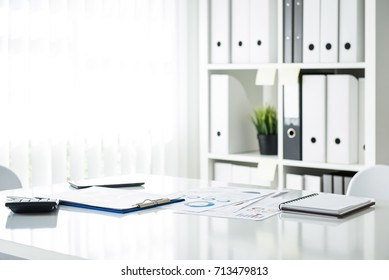 White business meeting room interior with documents on a table inside the office, no people