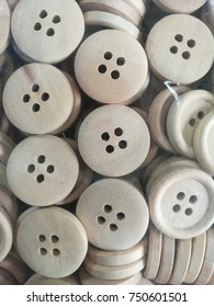 white buttons with four holes