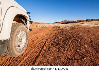 white for by four car on a sandy trail in the Kalahari desert, Namibia, Africa