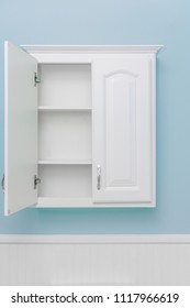 White cabinet, half open, empty space for product display, light blue wall paint, white beadboard or wainscoting