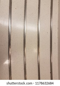 white cafeteria counter with metal grooves or tracks