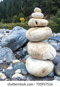 White Cairn On Riverbank