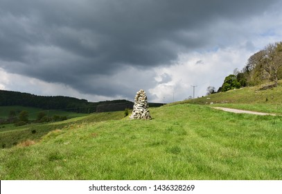 White cairn as a trail marker in Nothern England.