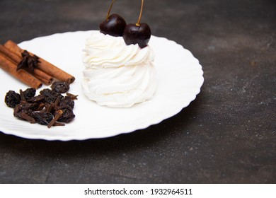 white cake with a cherry on a saucer or on plates