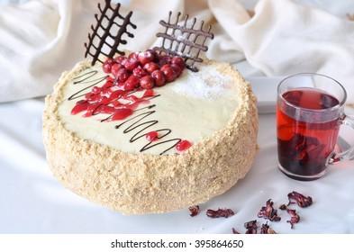 White cake decorated with cherries and dark chocolate