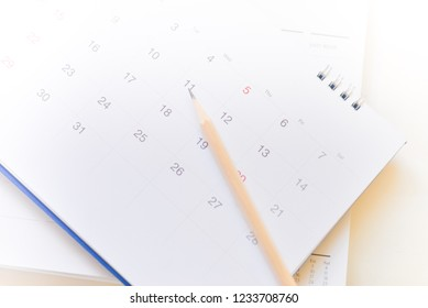 white calendar on white background.
