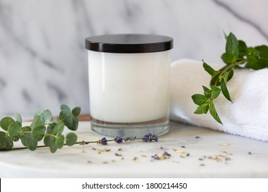 White Candle in Glass Jar