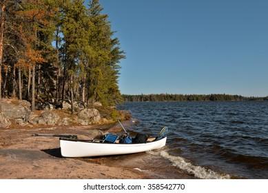White canoe and blue sky, Manitoba, Canada