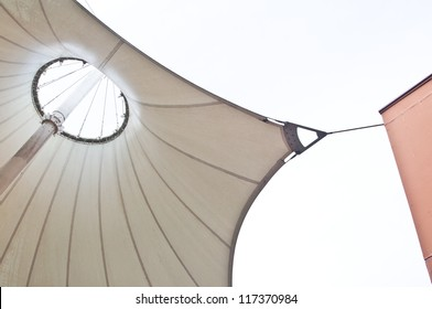 White canvas roof tent  and building