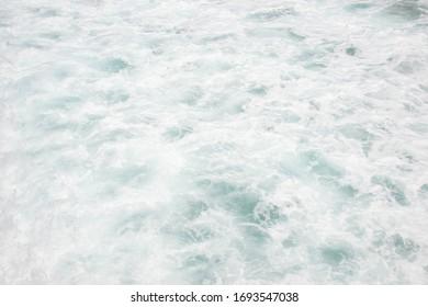 White Caps of Ocean Waves Crashing at the Seashore