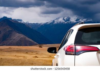 White car back view on mountanious Peru background