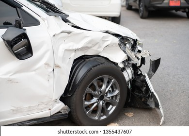 White car crash accident on the road damaged automobiles.
