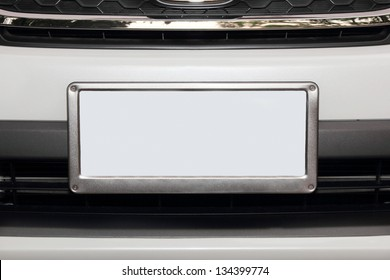 white car from front view  with empty white number plate