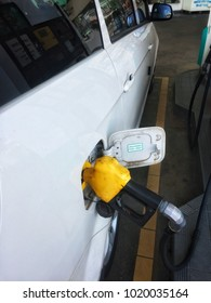 White car at gas station are being fuelled in Malaysia