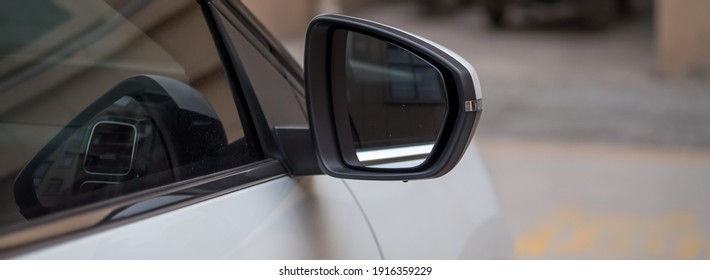 White car rearview mirror close-up