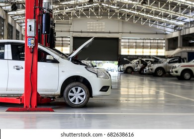 white car repair station with soft-focus in the background and over light