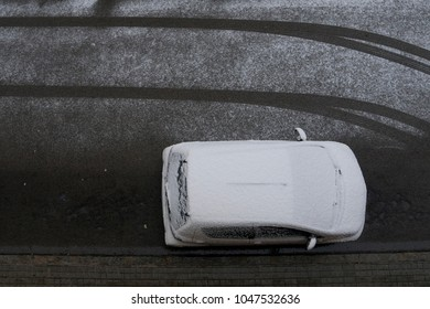 white car in snowy street