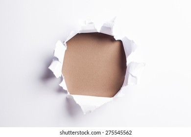White card with hold punched through - colorful brown background