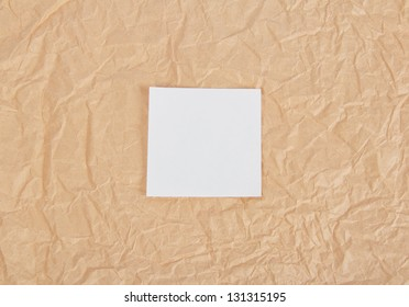 White card on packing paper. Background
