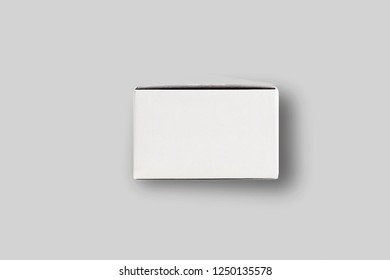 White cardboard box mock-up isolated on soft gray background.Cardboard package.High resolution photo.
