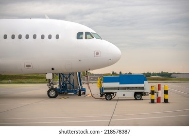 White cargo plane at airport refueling station