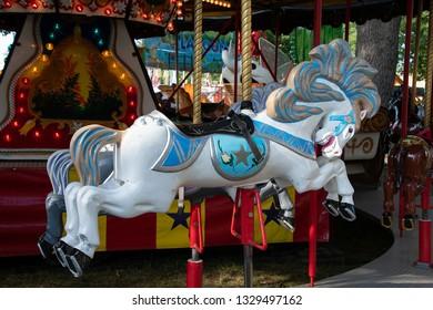 white carousel horse on merry go round