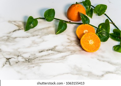 White carrara kitchen marble countertops with oranges on it