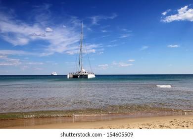 White catamaran near to the beach
