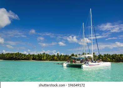 White catamaran on azure water against blue sky, Caribbean Islands