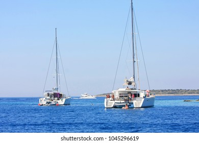 White catamarans on azure blue sea in Croatia