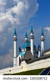 The White Cathedral Mosque of the Kazan Kremlin with 4 towers and bright blue domes, shot from behind the fortress wall