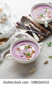 White cauliflower and purple sweet potato soup
