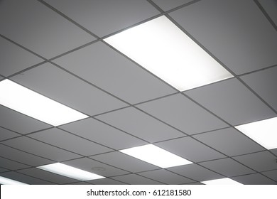White ceiling with neon light bulbs in uprisen view.as background interior decoration concept with copy space.
