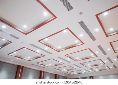 White ceiling with neon lights in the office. White ceiling can reflect light well. The right light at work. Abstract empty white interior space with office lights. copy space.
