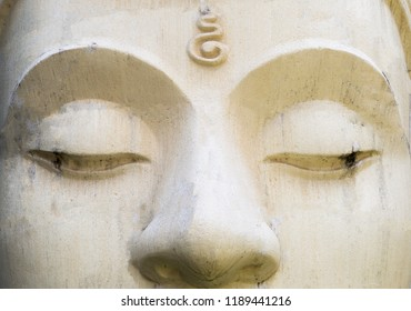 White cement Buddha image face, religion concept, Buddhism symbol