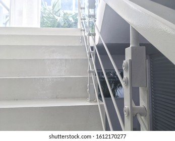 White Cement Staircase with Detail Steel Balustrade ,Selective Focus.