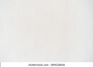 White cement texture stone concrete, rock plastered stucco wall painted flat fade pastel background egg yellow solid wall grain.