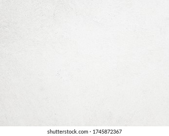 White cement wall background in vintage style for graphic design or wallpaper. Pattern of soft concrete floor in retro concept.