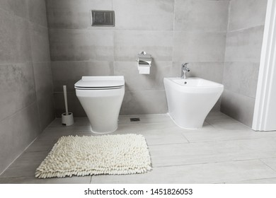 White ceramic bidet and toilet at luxury bathroom, nobody